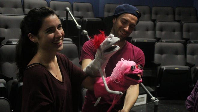 "Montana Lampert Hoover and Karl Gregory explore puppets in preparation for their roles in ""Hand to God"" by Robert Askins at Kitchen Theatre Company. The show opens Sept. 4."