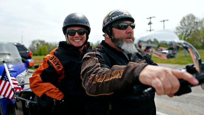 News-Leader reporter Jackie Rehwald and American Legion Post 639 commander Mike Goforth get ready to take part in a motorcycle ride along with members of Rolling Thunder MC, the American Legion and other groups making a trip to the College of the Ozarks campus in Point Lookout on Wednesday.