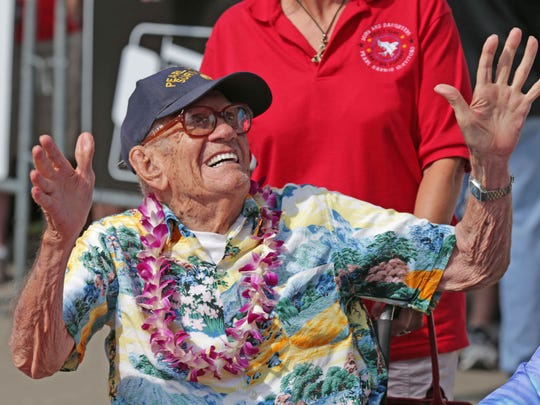 Pearl Harbor survivor Don Herther hams it up for the cameras during the 100th running of the Indianapolis 500, at the Indianapolis Motor Speedway, Sunday May 29th, 2016.