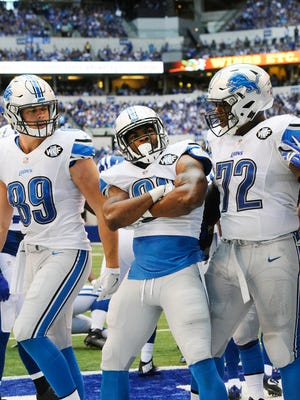 Lions' Dwayne Washington, center, could see more carries with the injury to Ameer Abdullah.