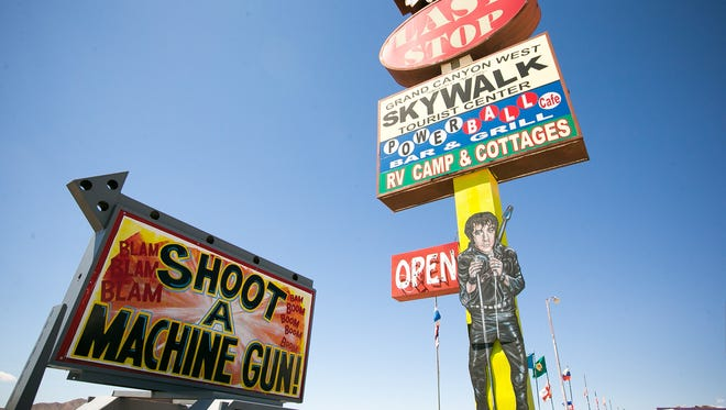 Signs advertising the shooting range at Arizona Last Stop in White Hills on Wednesday, August 27, 2014.