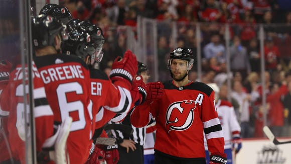 New Jersey Devils center Travis Zajac (19) celebrates his goal during the first period of their game against the Montreal Canadiens at Prudential Center.