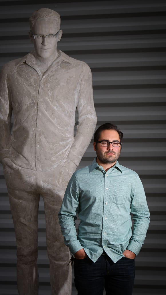 Jim Dessicino stands next to the statue of Edward Snowden that he made which now on display in front of the Delaware Center for the Contemporary Arts in Wilmington.