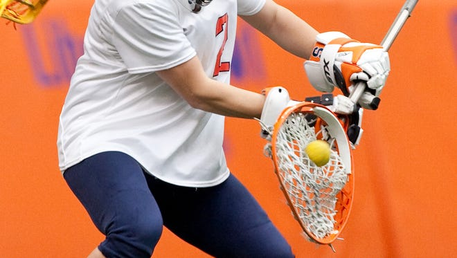 Liz Hogan, shown here playing for Syracuse University, was the fourth overall pick in a draft for a new women's pro lacrosse league. Credit: Syracuse University athletics
