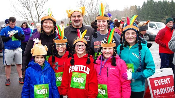 Entire families came out all dressed up for the 2014 Turkey Trot. (M. Rosenberry)