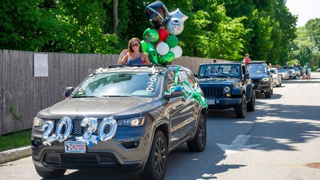 Duxbury High School graduates and their families paraded through town in celebration on Thursday, June 4, 2020. Tommy Colbért photos