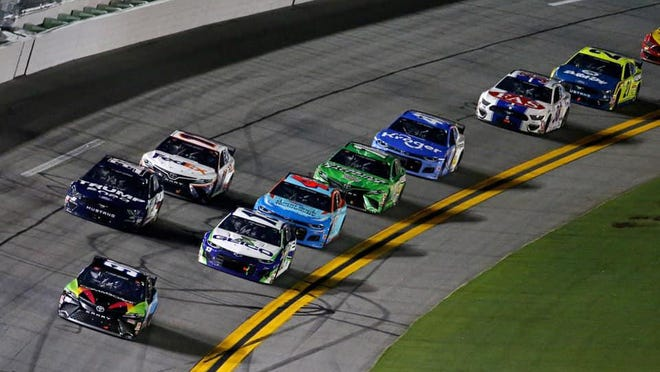 No. 96 car driver Daniel Suarez, whose spotter is Hendersonville's Steve Barkdoll, leads the field during Saturday night's Coke Zero 400 at Daytona International Speedway.