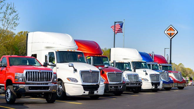 Trucks are lined up at West Michigan International/K&R Truck Sales/Idealease of West Michigan. The company donated 10 percent of profits from a special campaign in August to Feeding America West Michigan and VOX United.