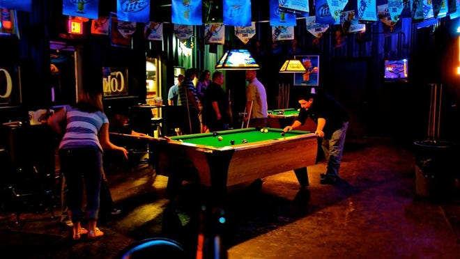 Ernie's is a Highland area bar offering a couple pool tables and dart boards, a DJ booth and separate lounge room with couches and a big screen television, as well as a fully stocked bar with 14 beers on tap.