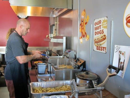 Chris DeLuca making hand-cut fries at his burger joint