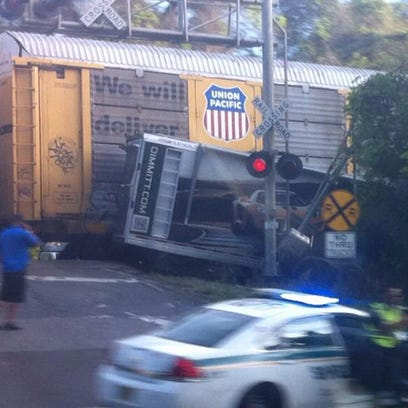 The train, which was moving slowly, struck the semi