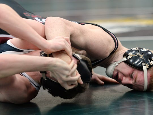 Pulaski wrestler Bradley Prentice, top, crossfaces