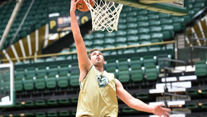 Braden Koelliker, one of five first-year players on the CSU men's basketball team, dunks during a Nov. 1 practdice. The Rams open the regular season with a home game Sunday against New Mexico State.