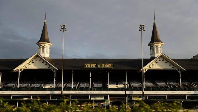 The sun rises over the track at Churchill Downs, Thursday, May 7, 2020, in Louisville, Ky. The Kentucky Derby has been postponed until Sept. 5 because of the coronavirus.
