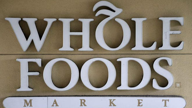 FILE - In this Aug. 28, 2017 file photo, a sign at a Whole Foods Market greets shoppers in Tampa, Fla.