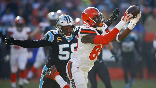 Cleveland Browns tight end David Njoku (85) catches a pass under pressure from Carolina Panthers outside linebacker Thomas Davis (58) during the first half of an NFL football game, Sunday, Dec. 9, 2018, in Cleveland.