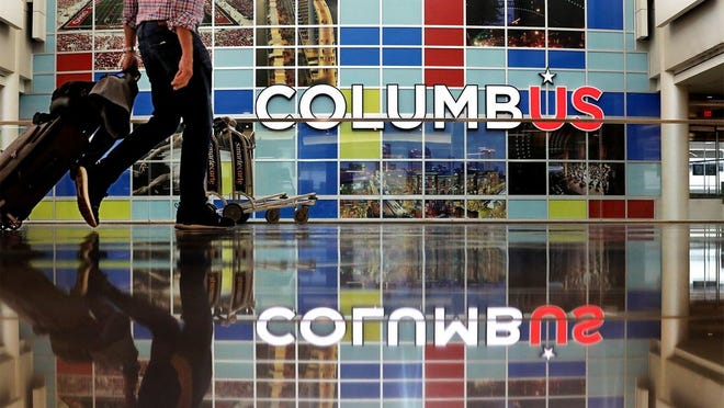 A traveler walks through the John Glenn Columbus International Airport terminal on Thursday.