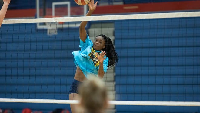 West Henderson's Deja Jackson hits the ball on the first day of practice for the West Henderson volleyball team on Wednesday at West.