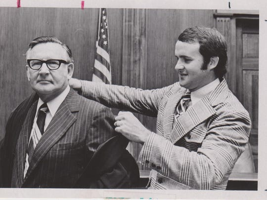 Guyte McCord III, right, helps his father, Guyte McCord Jr., don his judicial robes on his first day as an appellate judge in Januaruy 1974. Guyte McCord Jr., was a circuit judge from 1960 to 1974 and a judge on the First District Court of Appeal from 1974 to 1983.