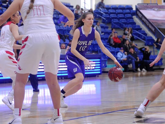 Wylie guard Abbey Henson (10) dribbles during the Lady Bulldogs' 44-41 loss to Denver City in the Region I-4A championship game at the Lubbock Christian University Rip Griffin Center on Saturday, Feb. 24, 2018.
