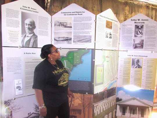 John W. Jones Museum President Talima Aaron shows off