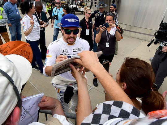 McLaren-Honda-Andretti IndyCar driver Fernando Alonso (29) signs autographs following his qualifying run for the Indianapolis 500 Friday, May 20, 2017, afternoon at the Indianapolis Motor Speedway.