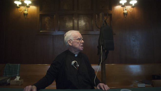 Monsignor Michael Doyle sits in the parish hall at Sacred Heart Church.