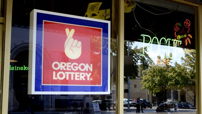 A Oregon Lottery sign hangs in the window of The Brick Bar & Broiler in downtown Salem.