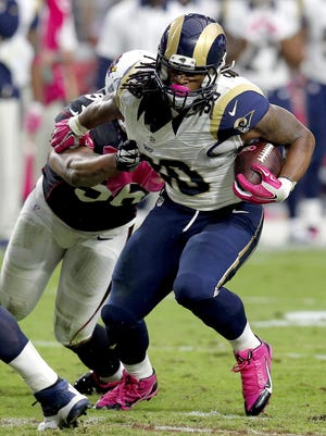 St. Louis Rams running back Todd Gurley rushed for all but five of 146 yards in the second half to help the Rams hold on to hand the Arizona Cardinals their first loss of the season, 24-22 on Sunday.
