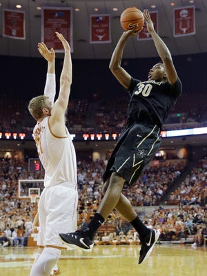 Vanderbilt center Damian Jones (30) shoots over Texas forward Connor Lammert (21) on Jan. 30, 2016.