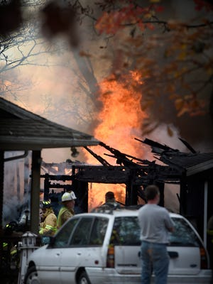 It took more than half an hour for firefighters to get control of flames that tore through a garage that housed antique vehicles.