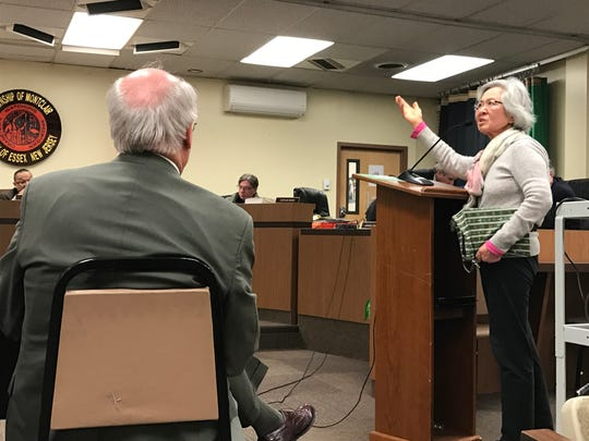 Resident Yahui Olenik addresses the planning board and consultant Peter Steck, left, during Monday night's planning board meeting.