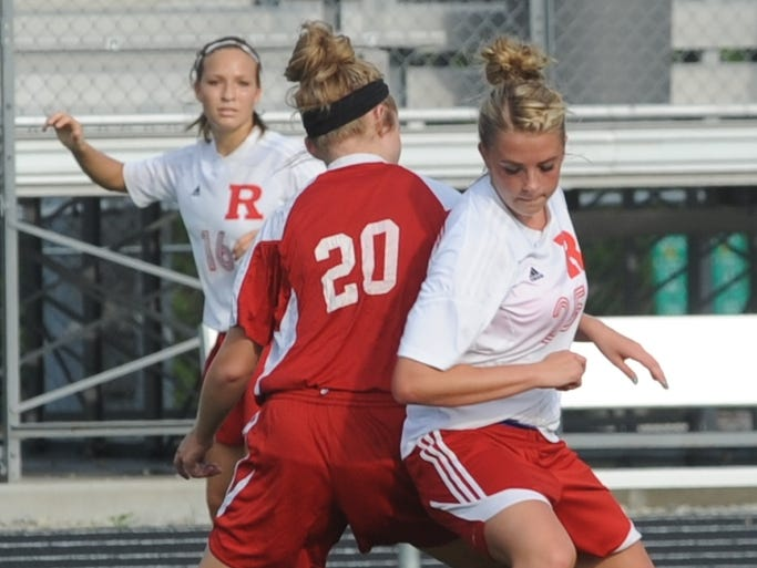 Richmond's Samantha Wilson makes a move around Connersville's Alexis Johnson during Thursday's game at Lyboult Field.