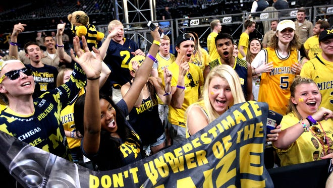 Michigan students cheer as they arrive at the team's student section before the national semifinal against Loyola-Chicago on Saturday, March 31, 2018, at the Alamodome in San Antonio.