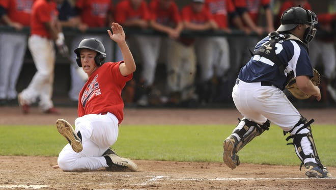 Evan Giordano of Gloucester Catholic slides safely into home with a second-inning run for Tri-Cape in Wednesday's Carpenter Cup game.