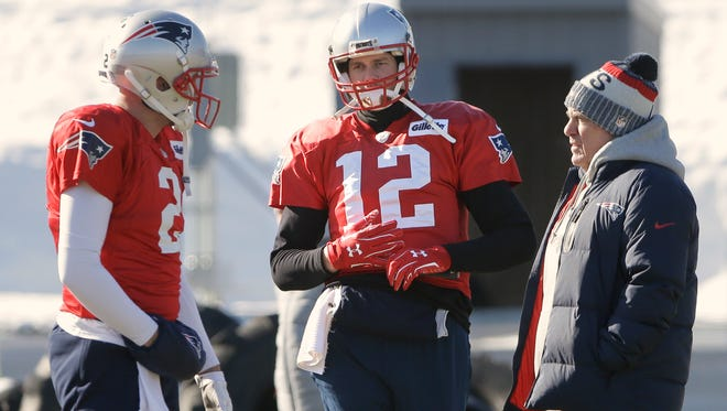 New England Patriots quarterbacks Brian Hoyer, left, and Tom Brady, center, stand with head coach Bill Belichick, right, during an NFL football practice, Thursday, Jan. 18, 2018, in Foxborough, Mass. The Patriots host the Jacksonville Jaguars in the AFC championship on Sunday in Foxborough.(AP Photo/Steven Senne)