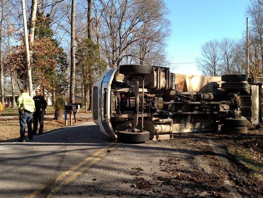 A garbage truck overturned on York Road Thursday morning.
