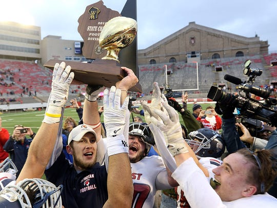 Brookfield East hoists the WIAA Division 2 state-championship trophy in 2016. The Spartans will look for another crown Nov. 22.