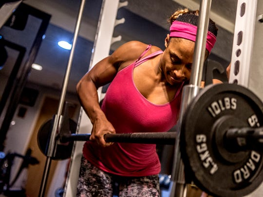 Kea Earley, 33, of Newark, trains earlier this fall for a bodybuilding competition. She has qualified for the NPC Junior Nationals Championships in Chicago in June.