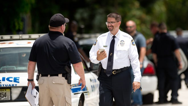 Stuart Police Chief David Dyess talks with his officers after a standoff was resolved peacefully Tuesday, June 13, 21017, near Palm Beach Road in Stuart. Dyess was named interim city manager of Stuart Monday, May 21, and will begin May 29. He will hold the position until the commission selects a permanent city manager.