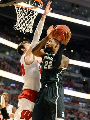 Branden Dawson had 16 points but the Spartans fell to No. 1-seed Wisconsin Sunday