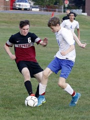 Robert McCarrick (6) of Elmira battles for possession against Chris Gibbons of Horseheads on Sept. 27 at Horseheads.