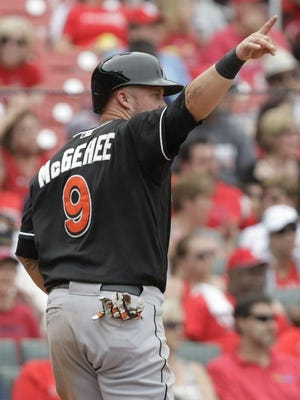 Miami Marlins' Casey McGehee celebrates after scoring the eventual winning run in the ninth inning of a baseball game against the St. Louis Cardinals, Saturday, July 5, 2014 in St. Louis. The Miami Marlins beat the St. Louis Cardinals 6-5.(AP Photo/Tom Gannam)