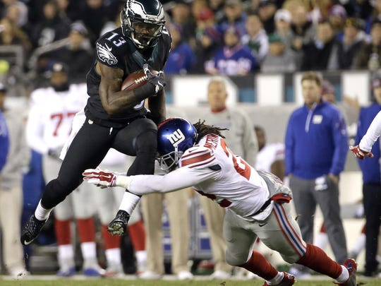 Eagles wide receiver Josh Huff, left, tries to avoid