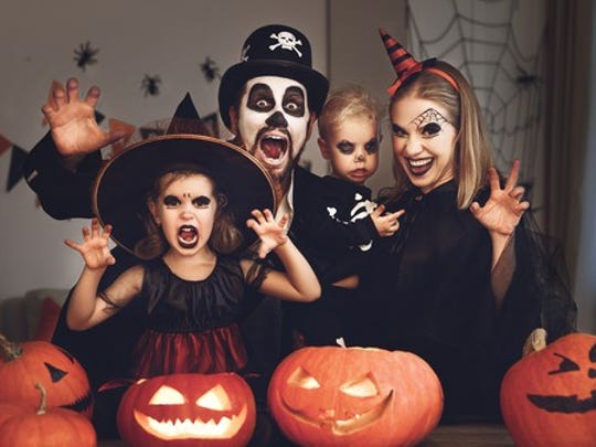 A family of four dressed up in scary Halloween costumes