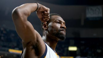 Memphis Grizzlies Tony Allen reacts after a Grizzlies scoring run against the Los Angeles Lakers.