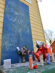 Candles, balloons and messages written in chalk create