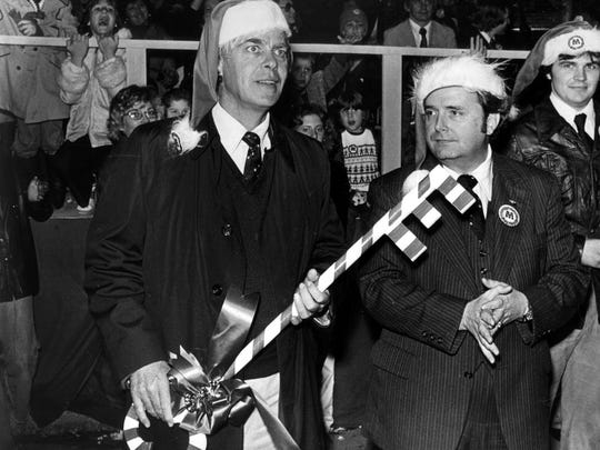 City of Memphis Mayor Wyeth Chandler (left) and Shelby County Mayor Roy Nixon (right) wait for the proper moment to present a key to the city, county and universe to Santa Claus at the Merry Christmas Memphis parade December 2, 1977.  Police estimated that more than 100,000 people lined the street for the 2 1/2 hour parade that began with the lighting of a Christmas tree on Overton Square near the corner of Madison and Cooper.   36 floats and acts and more than 50 bands participated in the parade.