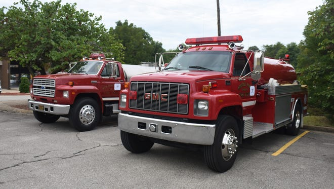 Two pumper trucks sit on display at the Mountain Home Fire Department's open house Saturday morning.