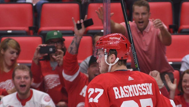 Sep 25, 2017; Detroit, MI, USA; Red Wings center Michael Rasmussen celebrates his goal in the first period against the Penguins at Little Caesars Arena.